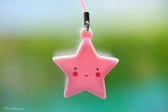 Shine as a star... (Maria Godfrida) Tags: lookingcloseonfriday smallfigures tiny cute pretty pink star smile mini bokeh light pastel keyring keychain