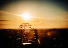 ferris wheel sunset (miemo) Tags: europe finland linnanmäki em5mkii evening ferriswheel helsinki horizon olympus omd panasonic25mmf17 silhouette sky spring sun sunset