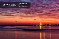 lighthouse of Cannes by night with beatiful sunset (jmlpyt) Tags: alpesmaritimes bay beach cannes chair cityscape coastline color image french riviera night provencealpescote dazur rock sea blue city dusk europe france outdoors photography summer sunset water lighthouse la croisette yacht sun red seascape côte canon reflets reflection light exposure longue long sky dramatic mountain coucher de soleil eau ciel crépuscule rivière gettyimages gettyimagescontributor skylum adagp jmlpyt