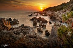 PuntaRossa Sunset (dwarfphotos) Tags: italia latina tramonto sunset mare water rocks scogli nikon d5200 sigmalens 1020