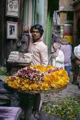 Flower Seller (JamesWired) Tags: asia india varanasi film flowers garland man negative seller selling