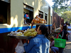 The train arrives and things get interesting (Claire Backhouse) Tags: hsipaw myanmar burma burmese people train station railway rail life living crazy hectic transport street streetphotography streetpic selling market sellers vendors tracks fruit vegetables snacks