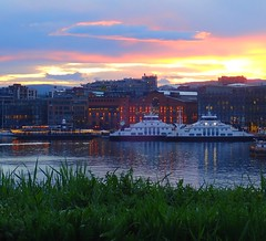 The ferry terminal at Aker brygge, seen from Akershus (trine.syvertsen) Tags: reflections sunset lovelycity city boat ferry akerbrygge oslofjord akershus norway oslo