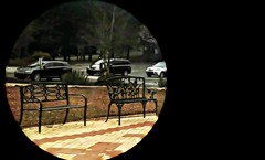 Waiting For Company (soniaadammurray - On & Off) Tags: parkinglot exterior vehicles globe pavers trees sign benches benchmonday iphone