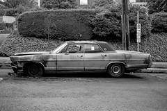 (el zopilote) Tags: portland oregon street cityscape architecture signs wheels cars ford ltd powerlines lumix gf1 lumixg20mmf17asph milc m43 bw bn nb blancoynegro blackwhite noiretblanc digitalbw bndigital schwarzweiss monochrome