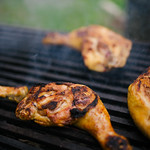 Grilled chicken drumsticks on a barbecue thumbnail
