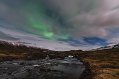 Hiking under the Northern lights (JusKlaud) Tags: iceland auroraborealis aurora gree lights northernlights stream water mountains snow capped longexposure