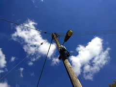 Look Up (IMHILL) Tags: sky clouds telegraphpole utilitypole blue white up upwards