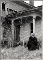 Paradox on location again (PhotoJester40) Tags: oldhouse abandonedhouse rundownhouse vintagestylehome paradox mask gargoyle posing bnw blackwhite blackandwhite noirblanc amdphotographer