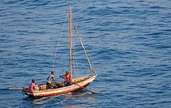 The 'Name of Jesus,' heading out to fish - Labadee, Haiti (TravelsWithDan) Tags: men boat rowing ocean caribbean canong3x haiti fishermen fishingboat water candid streetphotography island