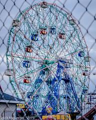 EM-190506-POST-003 (Minister Erik McGregor) Tags: erikmcgregor nyc newyork photography 9172258963 erikrivashotmailcom ©erikmcgregor usa photooftheday wonderwheel ferriswheel lunapark amusementpark offseason boardwalk coneyisland brooklyn icon historiclandmark fun thrills chainlinkfence fence cityscape streetphotography nikonphotography nikon