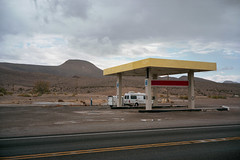(patrickjoust) Tags: fujica gw690 kodak portra 160 6x9 medium format 120 rangefinder 90mm f35 fujinon lens manual focus analog mechanical patrick joust patrickjoust nevada nv usa southwest us united states north america estados unidos small town desert cloud cloudy overcast alamo abandoned vacant empty gas station p mountain pahranagat dog walking camper van rv recreational vehicle self