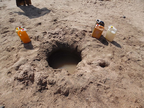 Hole in sand to tap shallow water, Djibouti