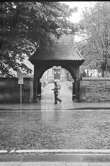Shelter (Mano Green) Tags: shelter rain street umbrella road fort william scotland uk spring may 2016 canon eos 300 40mm lens ilford xp2 super 400 35mm film black white