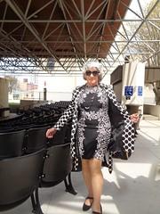 The Milwaukee Flasher (Laurette Victoria) Tags: raincoat dress sunglasses silver woman laurette downtown milwaukee