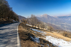 Mountain landscape from Valcava, Lombardy (clodio61) Tags: bergamo europe imagna italy lecco lombardy march valcava color day landscape mountain nature outdoor pass photography plant road scenic snow springtime sunny tree valley view