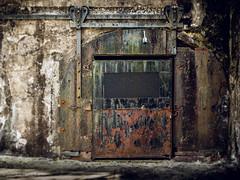rusty crusty door (Fort Hancock Sandy Hook NJ) (Steve Stanger) Tags: olympus olympusomdem10markii lumixg25mmf17 lumix 25mm prime microfourthirds m43 micro43 rusty crusty rustycrusty rustyandcrusty forthancock sandyhook nj concrete cracks rust crust ruins ruin historic history historical decay abandoned