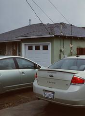 Sunnyvale, California (bior) Tags: pentax645nii pentax645 6x45cm ektachrome e200 kodakektachrome slidefilm mediumformat 120 sunnyvale street residential suburbs cars driveway house garage gray rain beige overcast