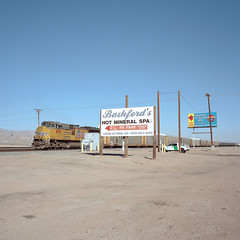 hot mineral spa. salton sea, ca. 2016. (eyetwist) Tags: eyetwistkevinballuff eyetwist bashfords hot mineral spa rvpark fountainofyouth sign billboard landscape empty saltonsea desert california ca111 mamiya 6mf 50mm kodak portra 160 mamiya6mf mamiya50mmf4l kodakportra160 ishootfilm analog analogue film mamiya6 square 6x6 mediumformat 120 filmexif iconla epsonv750pro lenstagger ishootkodak dirt sonorandesert dry bleak americantypologies imperialcounty roadsideamerica salton sea lonely desolate barren american west dead bombaybeach sand railroad tracks chocolatemountains type typography openallyear entrance arrow train locomotive unionpacific borderpatrol pickup crossing wasteland