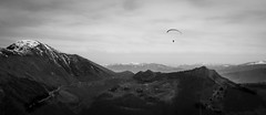 High (I wish I could be like a bird in the sky) (parenthesedemparenthese@yahoo.com) Tags: dem alone bn landscape monochrome nb noiretblanc sky blackandwhite blancoynegro bnw byn canon600d ef24mmf28 freedom italia laghiitaliani landscapephotography montebaldo mountains outdoor paragliding pareapente parenthesedemparenthese snowysummit spring