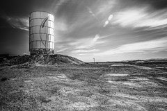 Newberry Springs, California (paccode) Tags: solemn d850 lonely desert brush blackwhite quiet watertank california abandoned monochrome horizon forgotten creepy landscape scary serious field newberrysprings unitedstatesofamerica