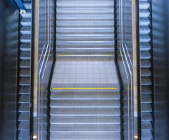 Up And Down (CoolMcFlash) Tags: geometry lines stairs escalator street person legs fujifilm xt2 vienna architecture city geometrie linien stufen rolltreppe strase beine wien architektur stadt fotografie photography xf1024mmf4 r ois symmetry symmetrie