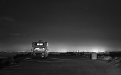 Lonely RV at the Pacific Grove shore (PeterThoeny) Tags: pacificgrove monterey california usa sky nightsky stars car rv recreationalvehicle camper parked road night outdoor monochrome blackandwhite sony a7 a7ii a7mii alpha7mii ilce7m2 fullframe vintagelens dreamlens canon50mmf095 canon 2xp raw photomatix hdr qualityhdr qualityhdrphotography fav30