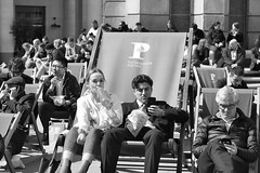 London: Seaside in the City.... (markwilkins64) Tags: london paternostersquare city thecity uk deckchairs sunny spring summer lunchtime mobilephones markwilkins mono monochrome blackandwhite candid streetphotography street streetscene seaside eyecontact urban lunch drink drinking