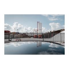 Admiralty Road (John Pettigrew) Tags: lines tamron d750 silos industrial reflections space tones clouds documentary imanoot angles topographics sky banal nikon mundane documenting johnpettigrew