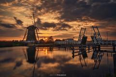 Kinderdijk sunset (Antoni Figueras) Tags: netherlands holland sunset europe windmill bridge water reflections clouds canal landscape antonifigueras sonya7riii sony1635f4