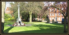 Contemplation (M E For Bees (Was Margaret Edge The Bee Girl)) Tags: outdoors canon newark nottinghamshire church churchofengland christianity anglican churchyard stmarymagdelene cenotaph trees shadows sun spring buildings redbricks quiet tranquility town cross blossom green grass sitting