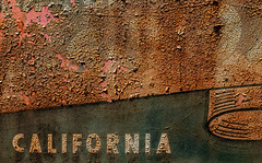 Western Promise (Junkstock) Tags: aged americana california campo corrosion corroded craquelure decay decayed distressed graphics graphic old oldstuff paint peelingpaint rust rusty rusted sign signage signs textures texture typography type text weathered
