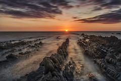 Balanced on the waves (Through Bri`s Lens) Tags: devon northdevon croydebay croyde thepoint downendpoint rocks sunset skies sky cloud skyascanvas epic brianspicer canon5dmk3 canon1635f4 leereversegrad