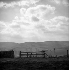 Familarity (ronet) Tags: hasselblad500cm bw blackwhite clouds fence film hasselblad ilforddelta100 mediumformat peakdistrict sky