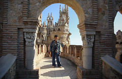 Kanitha in front of the ship of Columbus at  Colomares Castle (B℮n) Tags: spain andalusia andalusië castle monument castillodecolomares andalucía spanje mountains valley kasteel christopher colobus explorer holiday vacation mediterranean sea benalmádena castillo monumento colomares tourism sevilla olives sunflowers oranges winter drestebanmartín esteban martín gothic romanesquearchitecture byzantinearchitecture neomoorishstyle fairytale sprookjesachtig architecture 50faves topf50