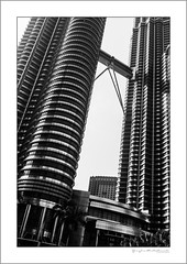 The iconic Petronas towers (G. Postlethwaite esq.) Tags: bw borneo fujx100t kl kualalumpur malaysia petronastowers singapore southeastasia unlimitedphotos blackandwhite monochrome photoborder