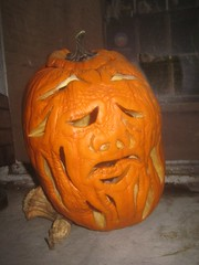 Pruneface from Dick Tracy 2008 Halloween Pumpkin 9914 (Brechtbug) Tags: second pruneface villain jack o lantern carved 2008 its various stages decay nyc window sill new york city holiday orange rotting gourd newspaper news paper cartoon comics sunday funnies strip prune face african art bird mexican skeleton