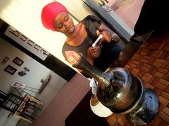 Uganda, Enjoying Ethiopian Coffee (SyrianSindibad) Tags: sindibadpanorama1 uganda jinja ethiopiancoffee bunna ann redhat stylish africa 2018 march