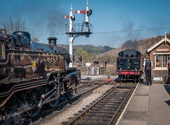 Meet at Levisham, NYMRwy. southbound train approaching us, signal man John Philip ready to secure the inbound occupancy tablet. (blair.kooistra) Tags: 2019 britain england heritage heritagerailways steam uk northyorkshiremoorsrailway railway locomotive northyorkmoors goathland whitby grosmont lms lner southernrailway