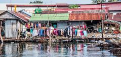 2019 - Cambodia - Sihanoukville - Tumnuk Rolok (Ted's photos - Returns late November) Tags: 2019 cambodia cropped nikon nikond750 nikonfx tedmcgrath tedsphotos vignetting reflection waterreflection washing laundry clothes clothesline water tumnukrolok tumnukroloksihanoukville tumnukrolokcambodia sihanoukville shacks wideangle widescreen ក្រុងព្រះសីហនុ