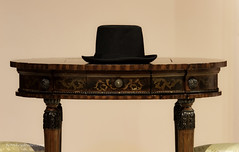 A hat. (Petoskey Drones) Tags: table hat black old