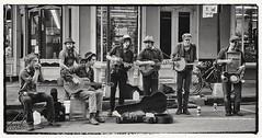 The New Orleans Restoration Blues Band (Bluescruiser1949) Tags: neworleans downtown buskerband stringbass harp mandolin banjo rubboard jug acousticguitar nationalsteelbodyguitar sevenplayers bw bourbonstreet louisiana busking martigras