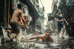 Rain and Flood can be fun (Mio Cade) Tags: rain flood streetphotography street fun kid swim aroma tondo philippines manila reportage documentary boy children child asia risk