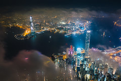 Aerial view of Hong Kong City skyline at night over the clouds (MongkolChuewong) Tags: above aerial aerialview architecture asia asian blue building buildings business china city cityscape coulds district downtown drone dusk evening flying harbor harbour hong hongkong kong landmark landscape light metropolis modern mountain night office panorama peak peaks scene sea sky skyline skyscraper sunrise sunset topview travel urban victoria victoriapeak view