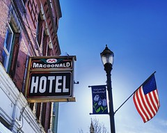 MacDonald Hotel (ekelly80) Tags: massachusetts marlborough april2019 spring newengland hotel sign old vintage macdonaldhotel building flag americanflag light evening sunset glow
