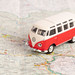 Red vintage camper van on map