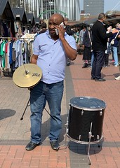 Has anyone seen the band? (paul indigo) Tags: drums streetphotography street phone carrying expression man
