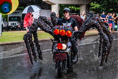Spider Motorcycle In Rain (burnt dirt) Tags: houston texas art car parade street streetphotography candid portrait woman man girl young latina asian blonde brunette redhead tights leggings yogapants city town couple lovers friends tattoo downtown pretty beautiful selfie fashion style people person costume cosplay bokeh outdoor shadow sunny rainy documentary xt3 fujifilm cute boots heels skates ponytail long short hair model park rain wet motorcycle moped helmet