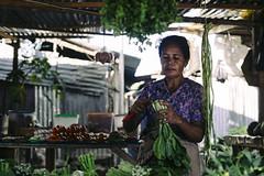 Fresh Veggies (JeffAmantea) Tags: dili timorleste est timor asia southeast indonesia portrait woman produce vegetable market outdoor food hustle sony alpha sonyalpha a7ii metabones mirrorless emount nikon nikkor 50mm f14