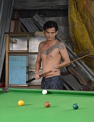 thinking over his next shot (the foreign photographer - ฝรั่งถ่) Tags: tattooed man billiards pool snooker table balls khlong thanon portraits bangkhen bangkok thailand canon